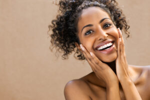 woman smiling after fantastic face treatment